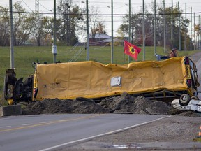 Protesters dug up the road on Argyle Street at the south end of Caledonia, Ont., adding an overturned school bus and car to the barricade in response to a judge granting a permanent injunction to McKenzie Meadows developers and Haldimand County after indigenous land defenders began an occupation of the residential construction site in July 2020.