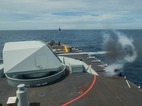Her Majesty's Canadian Ship Winnipeg conducts a range shoot in cooperation with the Japanese navy during a joint exercise on July 3, 2017.