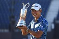 American Collin Morikawa poses with the Claret Jug after winning the 149th Open Championship at Royal St George's on Sunday in Sandwich, England.