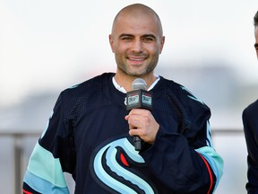 Mark Giordano is selected by the Seattle Kraken during the 2021 NHL Expansion Draft at Gas Works Park on July 21, 2021 in Seattle, Washington.