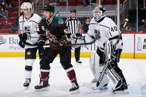 Michael Bunting plants himself in fron of Kings goalie Calvin Petersen during a game at Gila River Arena on May 05, 2021 in Glendale, Arizona.