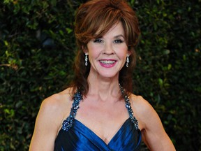 Oscar-nominated actress Linda Blair poses on arrival at the 3rd Annual Governors Awards in Hollywood on Nov. 12, 2011 in southern California.