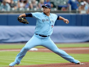 Blue Jays starter Hyun Jin Ryu pitches during the first inning against the Rangers in the first game of a doubleheader at Sahlen Field in Buffalo, N.Y., Sunday, July 18, 2021.