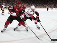 Colin White of the Ottawa Senators attempts to control the puck against Niklas Hjalmarsson of the Arizona Coyotes at Gila River Arena on October 30, 2018 in Glendale, Arizona.