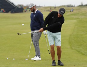 Phil Mickelson (right) and Jon Rahm get in some practise on Wednesday for this week's Open Championship at Royal St. George's in southern England.