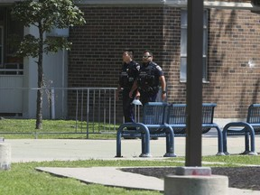 TCHC officers patrol a Falstaff Ave. highrise where a 12-year-old boy was shot on Friday night around 11 p.m. on Saturday, July 31, 2021.
