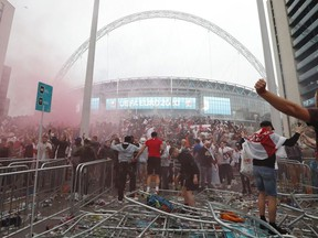 Soccer Football - Euro 2020 - Final - Fans gather for Italy v England - Wembley Stadium, London, Britain - July 11, 2021 Picture taken July 11, 2021 England fans celebrate outside Wembley Stadium during the match