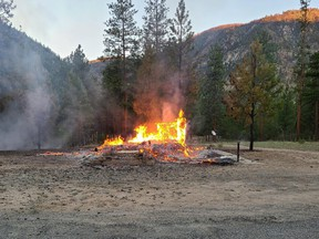 The burning remains of a church are shown in Chopaka, B.C. in a handout photo taken on Saturday, June 26, 2021. The chief of an Indigenous Nation in British Columbia's southern interior said two Catholic churches in the region had been burned down that day.