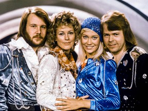 """From left to right: ABBA members Benny Andersson, Anni-Frid Lyngstad, Agnetha Faltskog and Bjorn Ulvaeus pose after winning the Swedish branch of the Eurovision Song Contest with their song """"Waterloo"""" in this picture taken in 1974 in Stockholm."""