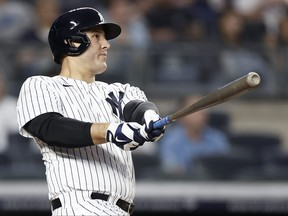Anthony Rizzo of the New York Yankees hits a home run against the Baltimore Orioles during the fourth inning at Yankee Stadium on Aug. 4, 2021 in New York City.