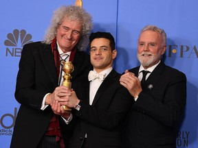 Rami Malek poses with Queen members Roger Taylor (right) and Brian May (left) during the 76th annual Golden Globe Awards on January 6, 2019, at the Beverly Hilton hotel in Beverly Hills.