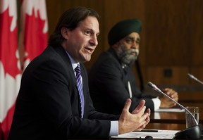 Immigration Minister Marco Mendicino, left, is joined by Harjit Sajjan, Minister of National Defence, at a press conference in Ottawa on Friday, July 23, 2021.