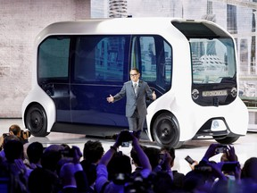 Toyota Motor Corporation President Akio Toyoda, shows the e-Palette autonomous concept vehicle at the Tokyo Motor Show, in Tokyo, Oct. 23, 2019.