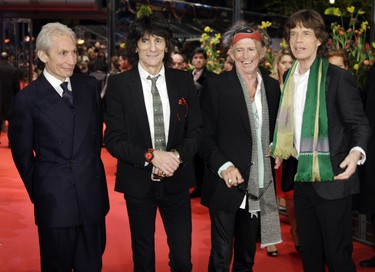 """Rolling Stones members (L-R) Charlie Watts, Ron Wood, Keith Richards and frontman Mick Jagger pose on the red carpet at the Berlinale palace ahead of the screening of their movie """"Shine a light"""" by director Martin Scorsese on the opening night of the Berlin Film Festival on February 7, 2008 in Berlin."""