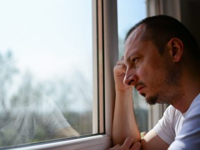 A man ponders leaving his wife for another woman.