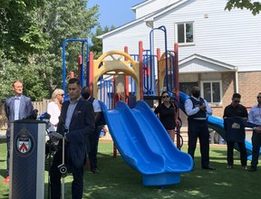 Crime Stoppers Chairman Sean Sportun speaks at Thursday's opening of a new playground where two girls were shot in the summer of 2018.