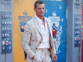 """Cast member Joel Kinnaman poses at the premiere for the film """"The Suicide Squad"""" in Los Angeles August 2, 2021."""