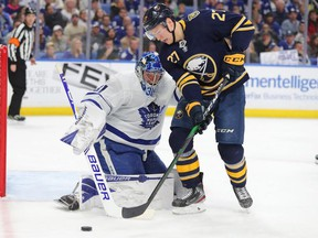 Toronto Maple Leafs goaltender Frederik Andersen (31) looks to make a save on Buffalo Sabres center Curtis Lazar (27) during the second period at KeyBank Center.