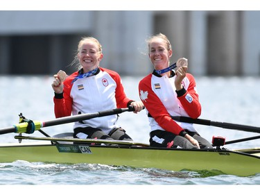 Tokyo 2020 Olympics - Rowing - Women's Pair - Medal Ceremony - Sea Forest Waterway, Tokyo, Japan - July 29, 2021 Bronze medallists Caileigh Filmer of Canada and Hillary Janssens of Canada celebrate with their medals in their boat REUTERS/Piroschka Van De Wouw