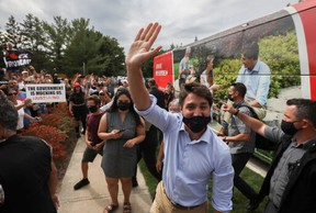 Canada's Liberal Prime Minister Justin Trudeau waves during his election campaign tour in Nobleton, Ont. on Aug. 27, 2021.