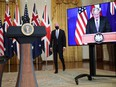 U.S. President Joe Biden walks to the podium before his remarks on an international security initiative involving the United States, the U.K. and Australia. British Prime Minister Boris Johnson (right) joined virtually on September 15, 2021.