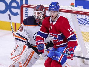 Montreal Canadiens' Jesperi Kotkaniemi sets up in front of Edmonton Oilers goalie Mikko Loskinen during second period in Montreal on May 10, 2021.