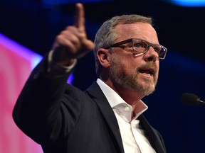 Brad Wall, former premier of Saskatchewan speaks at the United Conservative Party's 2018 annual general meeting and founding convention in Red Deer, May 5, 2018.