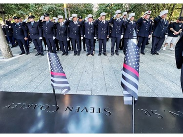 Firefighters from FDNY Engine Company 217, Brooklyn, salute near the name of their fallen colleagues during a ceremony at the National September 11 Memorial & Museum commemorating the 20th anniversary of the September 11th terrorist attacks on the World Trade Center on Sept. 11, 2021 in New York City.