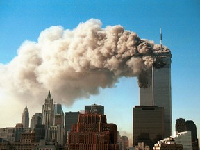Smoke pours from the twin towers of the World Trade Center after they were hit by two hijacked airliners in a terrorist attack Sept. 11, 2001 in New York City.