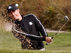 Team Europe's Rory McIlroy hits out of a bunkder during practice at the Ryder Cup on Thursday. REUTERS/