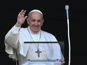 Pope Francis speaks to the faithfuls from the window of his study overlooking St.Peter's Square in the Vatican on September 19, 2021 as part of the Angelus prayer.