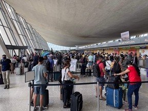 In this file photo passengers are seen at Dulles Washington International Airport (IAD) in Dulles, Virginia, on August 14, 2021.