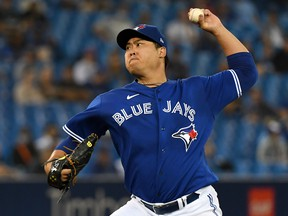 Toronto Blue Jays starting pitcher Hyun Jin Ryu (99) throws against the Minnesota Twins at Rogers Centre.