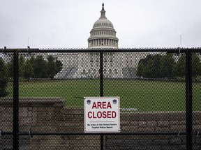 The U.S. Capitol stands behind security fencing on Sept. 17, 2021 in Washington, D.C.