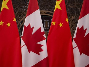 In this file photo taken on Dec. 5, 2017, shows Canadian and Chinese flags taken prior to a meeting with Prime Minister Justin Trudeau and China's President Xi Jinping at the Diaoyutai State Guesthouse in Beijing.