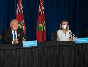 Ontario Premier Doug Ford, second left, responds to a question as Dr. Kieran Moore, Chief Medical Officer of Health,   Christine Elliott, Deputy Premier and Minister of Health, and Kaleed Rasheed, Associate Minister of Digital Government,   listen, during a press conference at Queen's Park in Toronto  on Wednesday, September 1, 2021.  THE CANADIAN PRESS/ Tijana Martin ORG XMIT: TIJ101