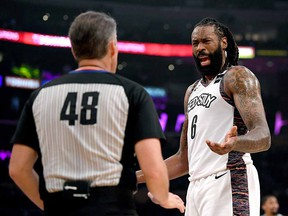 DeAndre Jordan of the Brooklyn Nets argues a call with referee Scott Foster against the Los Angeles Lakers at Staples Center on March 10, 2020 in Los Angeles.