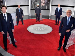 Prime Minister and leader of the Liberal Party Justin Trudeau, Bloc Quebecois leader Yves-Francois Blanchet, NDP leader Jagmeet Singh, Conservative leader Erin O'Toole and Canadian journalist Pierre Bruneau pose for the official photo at the TVA studios ahead of the Face-a-Face 2021 debate in Montreal, Sept. 2, 2021.