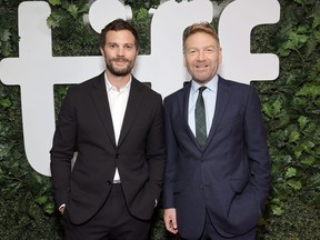 """Jamie Dornan and Kenneth Branagh attend the """"Belfast"""" Premiere during the 2021 Toronto International Film Festival at Roy Thomson Hall on Sept. 12, 2021 in Toronto."""