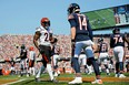Cincinnati Bengals strong safety Vonn Bell (24) talks to Chicago Bears quarterback Andy Dalton (14) after a play and was penalized for taunting during the first quarter at Soldier Field in Chicago Sept. 19, 2021.