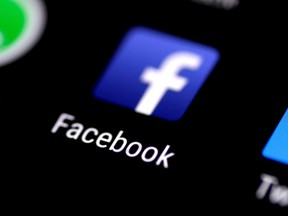The Facebook app is seen on a phone screen August 3, 2017.