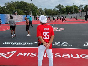 Raptors Superfan Nav Bhatia (centre) and Mayor Bonnie Crombie were on hand  at Mississauga's Paul Coffey Park on Saturday to officially open a new outdoor basketball facility.