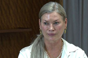 This video grab taken from AFPTV on September 7, 2021 shows Carre Sutton, known as Carrie Otis, a former US Elite model and actress, reacting as she gives a press conference in Paris after filing a criminal complaint in New York last month against Gerald Marie, the former Europe chief of the Elite modelling agency, accusing him of serial sexual assault starting when she was 17.