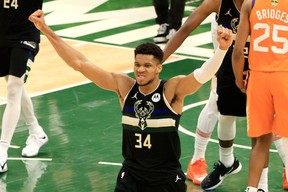 Giannis Antetokounmpo #34 of the Milwaukee Bucks celebrates in the final second before defeating the Phoenix Suns in Game Six to win the 2021 NBA Finals at Fiserv Forum on July 20, 2021 in Milwaukee, Wisconsin.