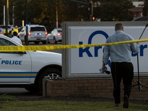 Crime scene tape is seen outside of a Kroger grocery store where a shooting occurred in Collierville, Tenn., Thursday, Sept. 23, 2021.