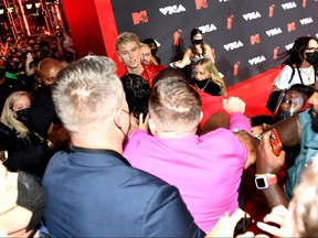 Machine Gun Kelly and Conor McGregor (dressed in pink) appear to be in a scuffle at red carpet of the 2021 MTV Video Music Awards at Barclays Center on Sept. 12, 2021 in the Brooklyn borough of New York City.