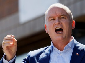 Canada's opposition Conservative Party leader Erin O'Toole speaks during campaign stop at a  constituency office in Markham, Ont., Sept. 19, 2021.