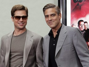 """Brad Pitt (left) and George Clooney are seen after both actors immortalized their prints in cement in the famed forecourt of Grauman's Chinese Theatre in celebration of their movie, """"Ocean's Thirteen"""", in Hollywood, Calif., June 5, 2007."""