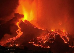 Lava pours out of a volcano in the Cumbre Vieja national park at El Paso, on the Canary Island of La Palma, September 19, 2021, in this screen grab taken from a video. FORTA/Handout via REUTERS