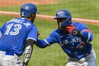 Blue Jays' Teoscar Hernandez (right) and teammate Lourdes Gurriel Jr. after hitting a grand slam home run during the third inning at Oriole Park at Camden Yards on Sunday, Sept. 12, 2021.